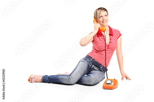 Young girl talking on a vintage phone