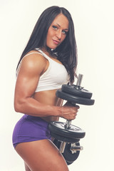 Portrait of sexy woman in gym with dumbbells