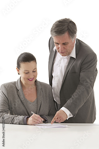 bsiuness man  pointing document to businesswoman