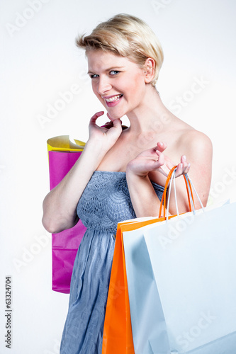 Woman smiling and holding paper bags
