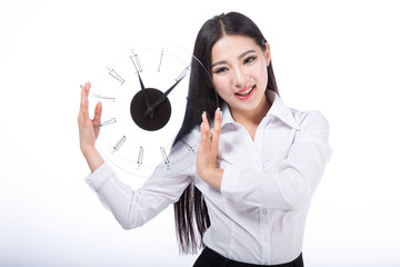 young woman holding a clock.