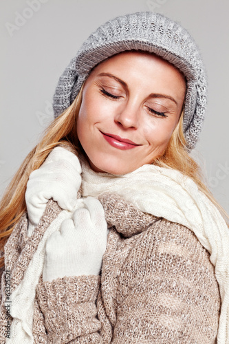 Woman relaxing in fall fashion isolated on grey