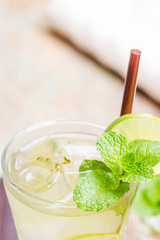 Fresh and cold ice green tea with sliced lime and mint