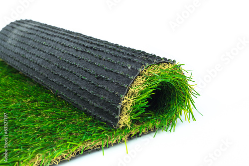 Artificial turf green grass roll on white background - 63327197