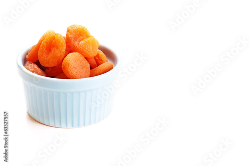 Dry apricots in blue bowl.