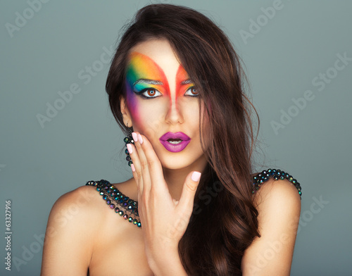 girl with a fashion bright multicolored makeup of eyes