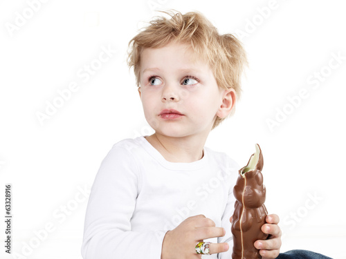 Cute little boy with chocolate bunny