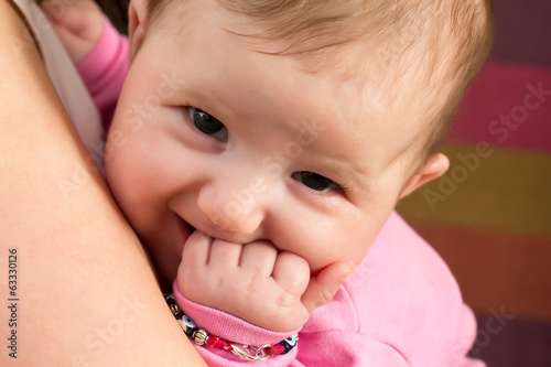 Baby girl on mother's hands wants to eat