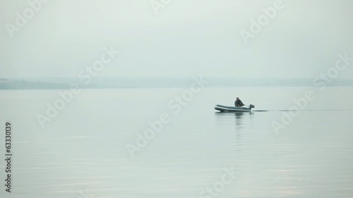 Fishing boat  morning on the lake