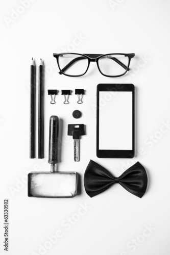 Business objects in order on white desk.