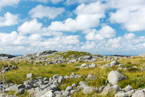 Stony landscape with blue sky with white clouds.