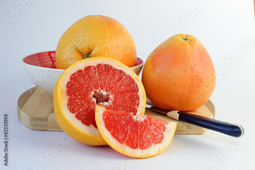 Juicy grapefruit on a cutting board.