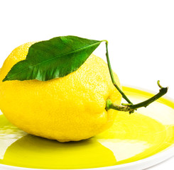 Lemon on yellow plate isolated on white background. Fresh Ripe