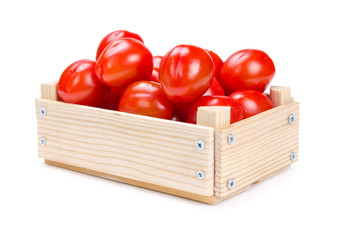 Wooden box with tomatoes