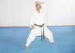 Black belt karate man in defending position