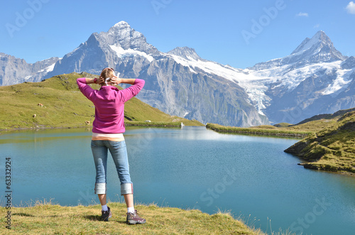 Girl against Alpine scenery. Switzerland