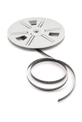 Film reel with film on white background