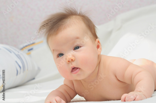 Newborn baby learning to hold head