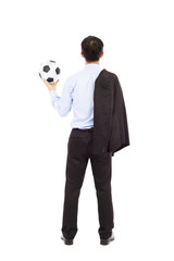 Back view of young business man with soccer ball