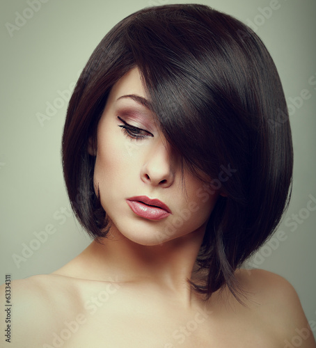Art portrait of short hair woman looking down. Closeup