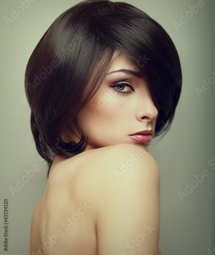 Vogue portrait of alluring woman with short hair style. Closeup