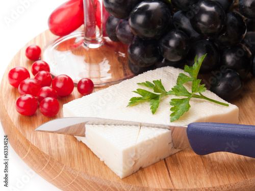 feta cheese and cranberries on wooden cutting board