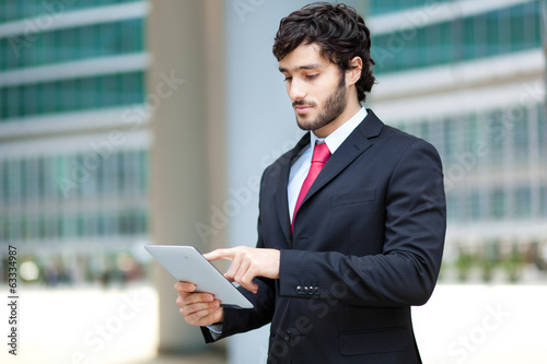 Handsome businessman using a tablet