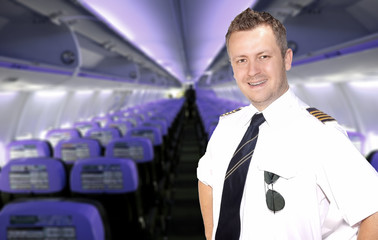 Smiling pilot in the cabin of the aircraft