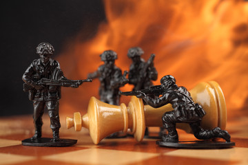 Toy soldiers fighting chess King