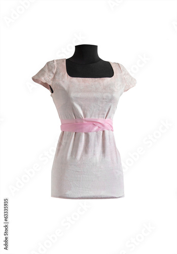 light pink dress with pink ribbon on a mannequin