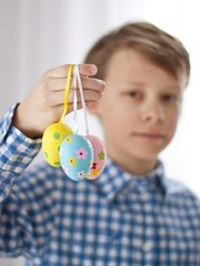 Boy holding easter eggs