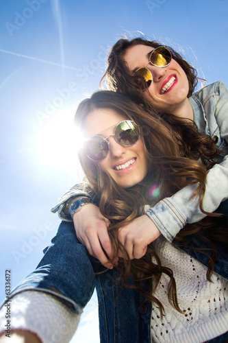 Selfie girls taking photos with a smartphone