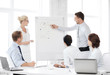 business team working with flipchart in office