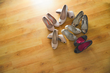 Several pairs of women's shoes sitting on the floor