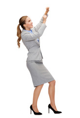 smiling businesswoman pulling imaginary rope