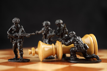 Toy soldiers kill chess King