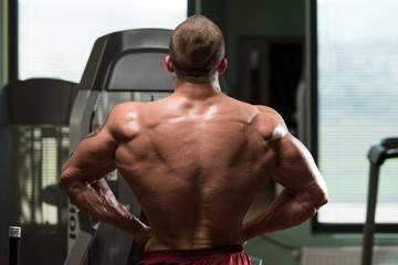 Bodybuilder Performing Rear Lat Spread Pose