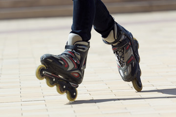 Close-up view of male legs in roller blades