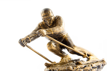 Gold ski champion statuette award isolated on white background
