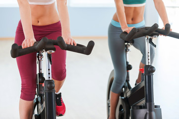 Girls on exercise bikes.