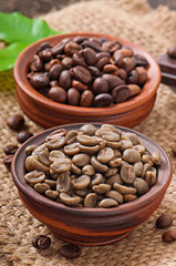 Green and brown coffee beans in bowls
