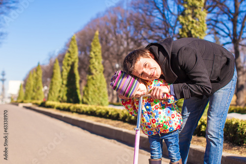 Portrait of adorable little girl and happy father ride on
