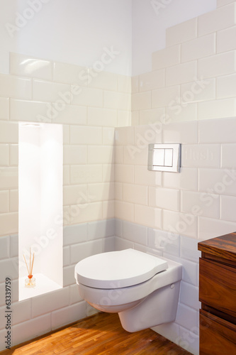 Toilet in bathroom interior