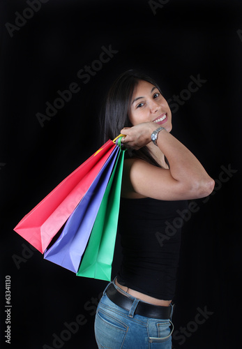 Woman with shopping bags black background