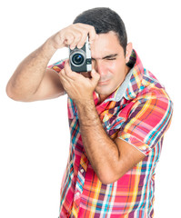 Hispanic man using a compact camera isolated on white