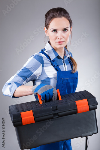 Woman holding a toolbox