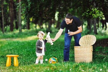 Father and daughter having fun together - outdoors portrait