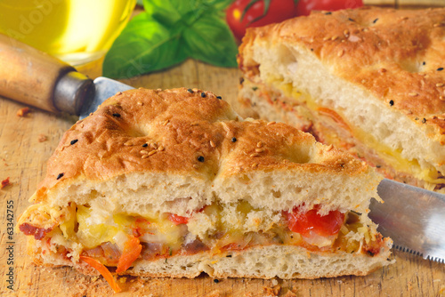 Bread filled with ham, cheese and tomato.