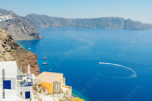 View of the  sea  with the high coast of the island of Santorini