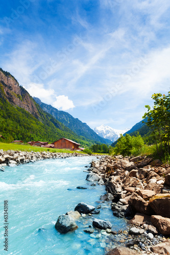 Beautiful Swiss landscape with river stream - 63343198
